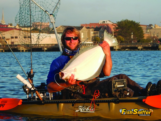 Matt Mayes was all smiles after putting this impressive 33.5 inch Humboldt Bay halibut into his kayak.