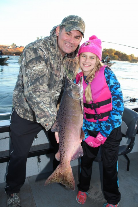 Jeff Bosshard and his daughter, Vivica, pose proudly with the king salmon that she caught while fishing the Feather River below the Thermalito Afterbay Outlet with Robert Weese of Northern California Guide Service on October 6, 2016.