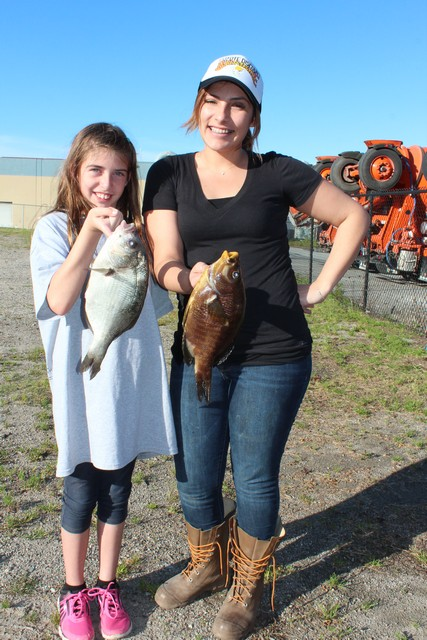 Kira Eccleston (right) won first place in the women's sea perch division with a 1.9 lb. 12-3/4 inch rainbow perch taken while fishing off Monterey with a bloodworm.
