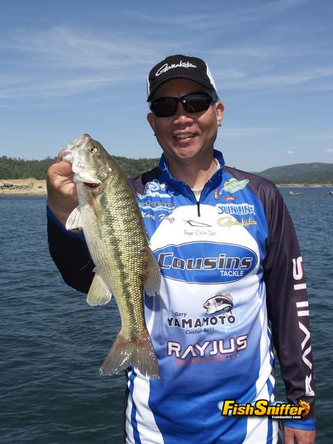 Mark Fong with spotted bass_web