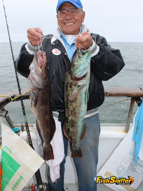 Roger Mammon, president of the CSBA West Delta Chapter, holds up a couple of lingcod fooled with live anchovies aboard the California Dawn.