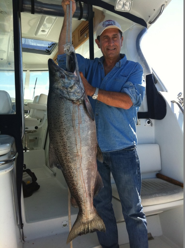 Victor Gonella, Founder and Treasurer of the Golden Gate Salmon Association (GGSA), shows off a huge Chinook salmon that he landed while trolling off Bodega Bay.