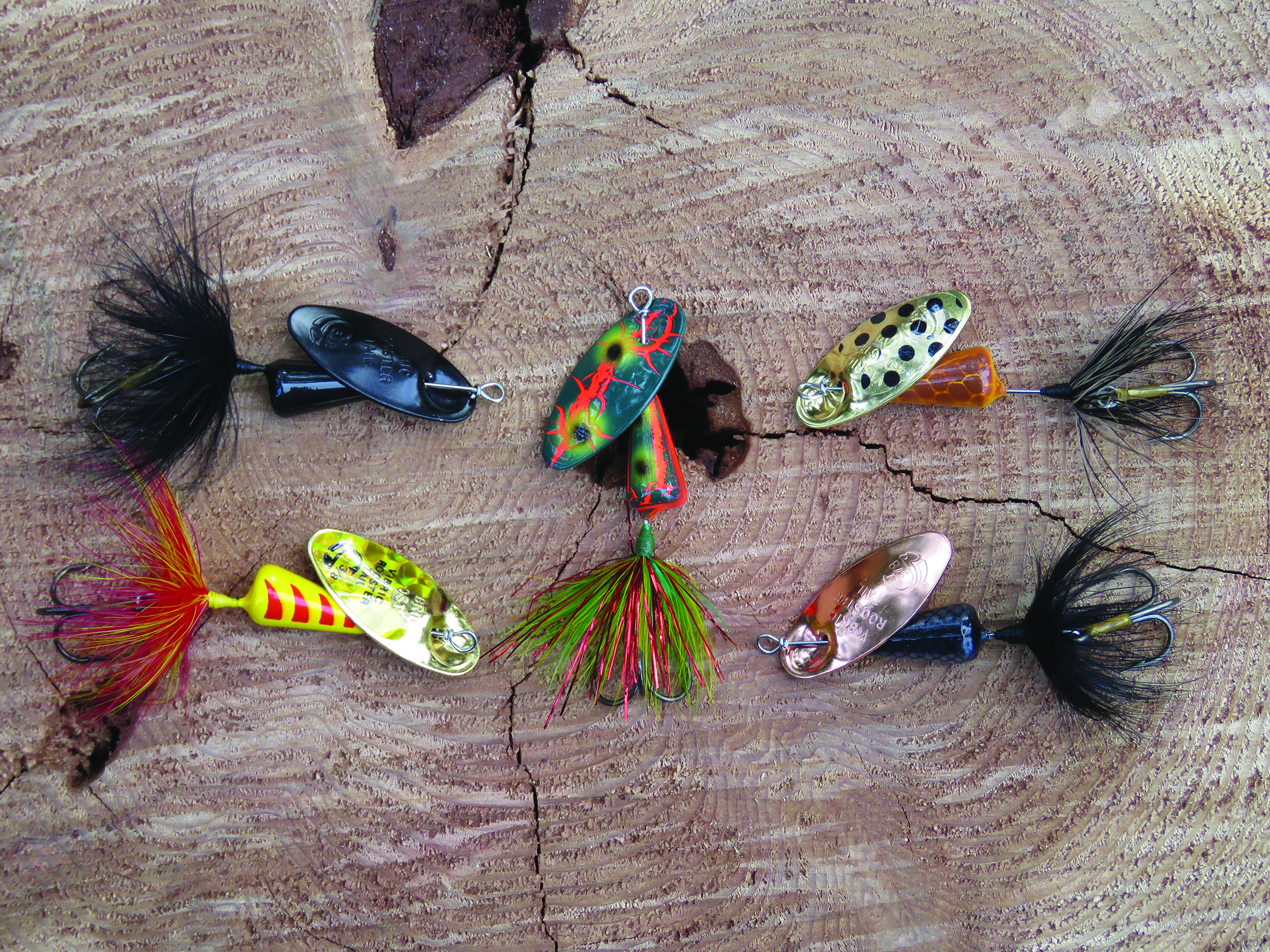 You don't want to overlook spinners when it's time to cast for trout. Here we see a selection of Vibric Rooster Tails. These lures cast well and can be buzzed just beneath the surface or counted down in much the same way you'd fish a spoon. Don't be afraid to add some twitches and pauses to your retrieve.