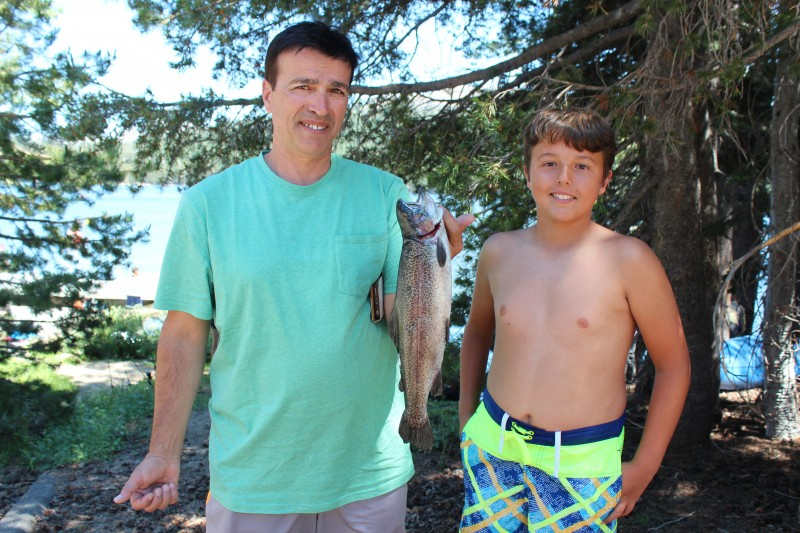 Ryan E. and his dad show off this 16 inch rainbow, the first fish caught during the Lake Alpine Kid's Fishing Day on July 15, while soaking PowerBait from shore.