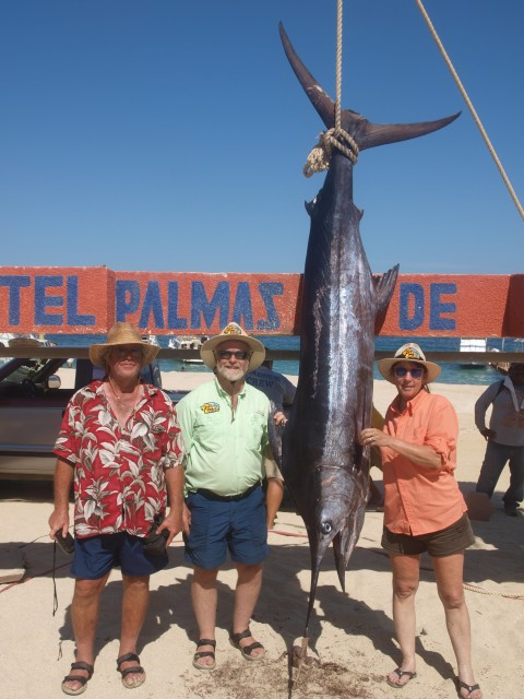 Ken and Paul Kneeland and Bridget Looney with the 280 pound blue marlin that died at the boat after an hour and a half fight in Baja's East Cape.